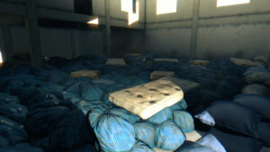 An huge amount of blue garbage bags and a mattress in the foreground
