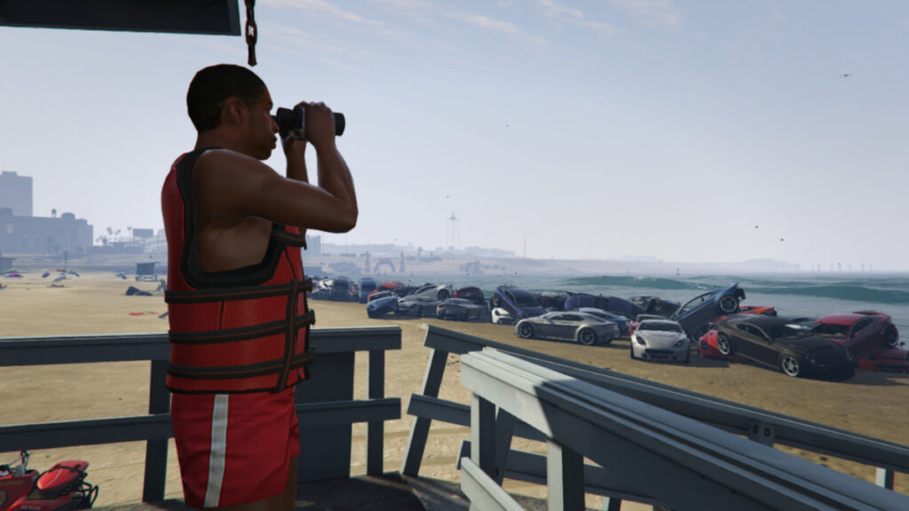 a lifeguard that looks to the sea and a wall of cars along the seashore